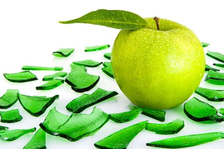Green apple with leaf and the broken green glass Stock Photo