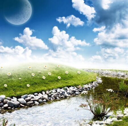 beautiful hill valley reflection on stream surface Stock Photo