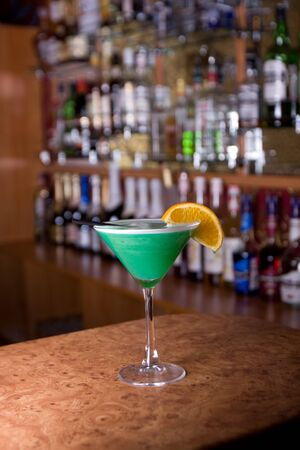 Green cocktail with green lemon Stock Photo