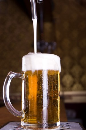 Glass of beer on pub