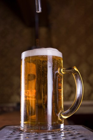 Glass of beer on pub photo