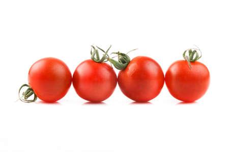 lycopene: fresh tomatoes on white background