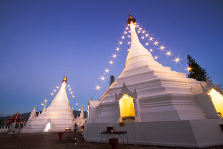 aisa: Thailand white temple and twilight sunset sky. Place name Wat Phra That Doi Kong Mu the landmark of Mae Hong Son province. Located at northern of Thailand.