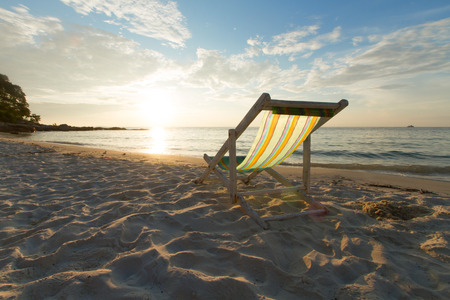 Landscape of chair on sandy beach at sunset in holiday. relaxation concept. 스톡 콘텐츠