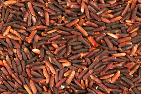 healthy grains: Top view of brown rice or rice berry, healthy grains background Stock Photo