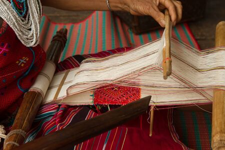 tribes: Tribes weave silk threads to cloth Stock Photo