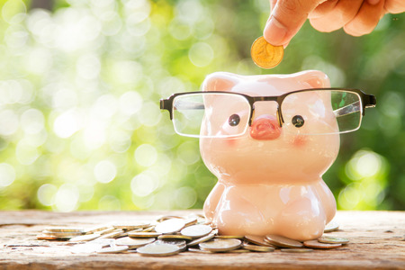 Piggy bank glasses concept for retirement, pension and business investment.