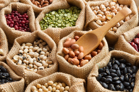 Colorful Bean seed in linen sack with wooden spoon Archivio Fotografico