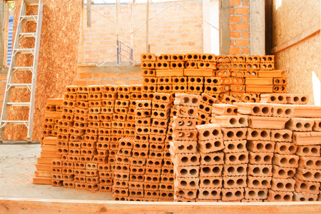 industrial Bricks ready to installing bricklayer at home construction site