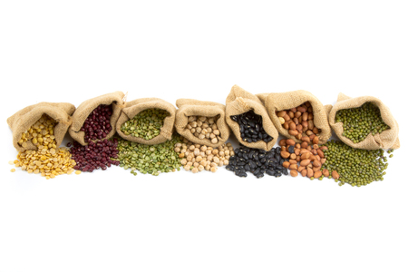 Various of legumes in sack bag isolated white background