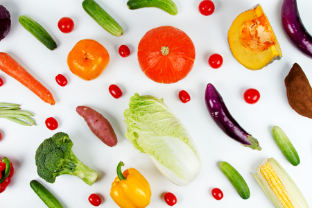 Mixed fruit and vegetable on isolated white background
