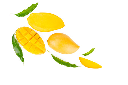Mango and leaves flat lay on isolated white background, top view