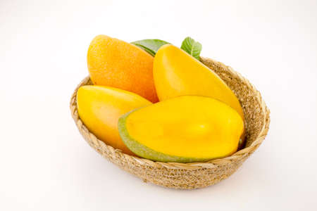 Mango fruits with Sliced piece and green leaf isolated white background. 스톡 콘텐츠