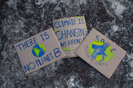 Climate change Protest sign put on ground.
