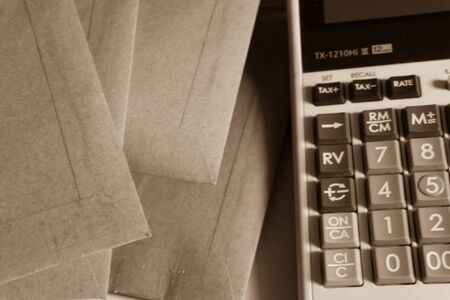 envelop: envelop and calculator, sepia tone,