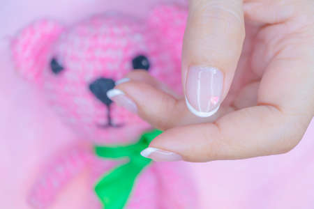 close up beautiful white french manicure on woman short fingernail decorated  with cute pastel litte heart 写真素材