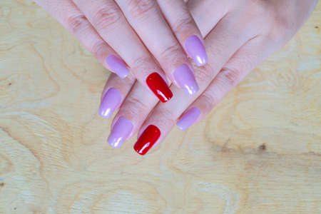 sweet shiny baby violet and dark red colr gel polish painting on long square shape woman fingernail 写真素材