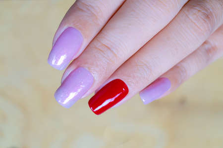 close up sweet shiny baby violet and dark red colr gel polish painting on long square shape woman fingernail 写真素材