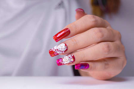 sparkling red color gel polish painting 3D white rose flower decorate d with shiny rhinestone and glitter on fashionista woman long square shape acrylic fingernail