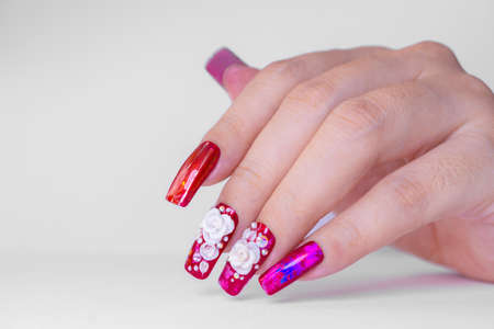 beautiful sparkling red color gel polish painting 3D rose flower decorate d with shiny rhinestone and glitter on fashionista woman long square shape acrylic fingernail 写真素材