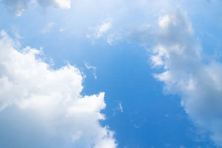 Scattered white clouds on blue sky with sunlight for background. Cloudy day in summer. Reklamní fotografie