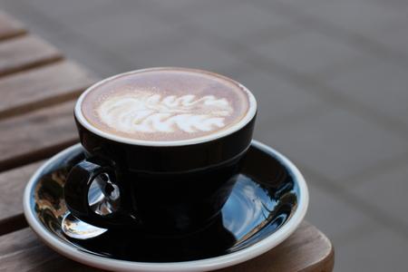 capuchino: A cup of coffee capuchino