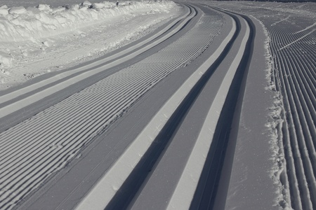 Freshly prepared track for nordic skiing, with sparkling snow. photo