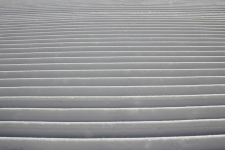 A closeup of a freshly groomed ski track. photo
