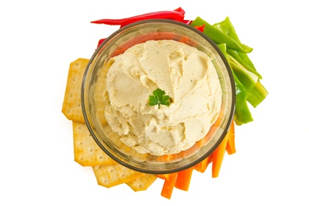 humus: Bowl of hummus dip with vegetables and crackers, isolated on white