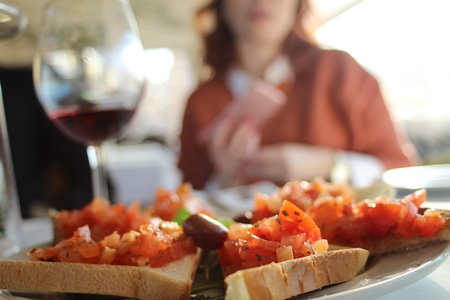 likeable: delicious toast on the table and the girl in the background Stock Photo