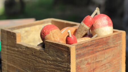 Old wooden box with fishing floats