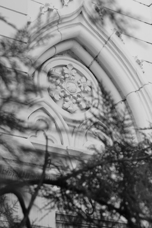 noteworthy: ornament on the facade of the church, black and white