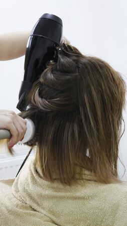 Close-up of hair dryer, concept barber salon, female stylist. Imagens