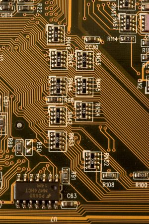 ttl: amber PCB board with small devices Stock Photo
