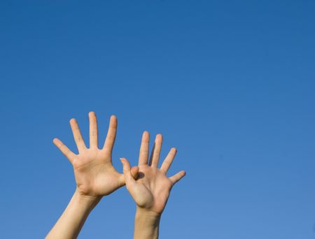 pair of hands raised up in the air photo