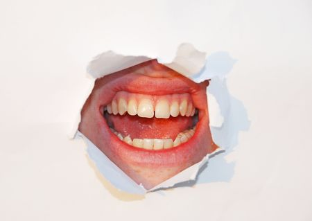 dentition: mouth through paper Stock Photo