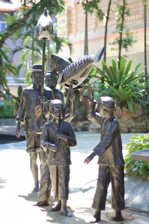 statue of fishing family photo