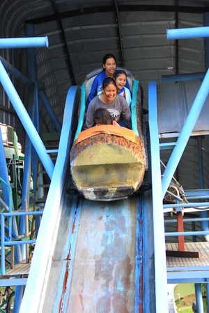 thrill: A Wooden Boat on a Fun Fair Log Flume Ride