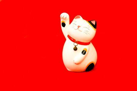neko: maneki neko lucky cat on red background