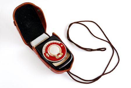 Vintage light meter in a leather case on a small strap photo