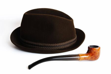 Hat and pipe on a white background photo