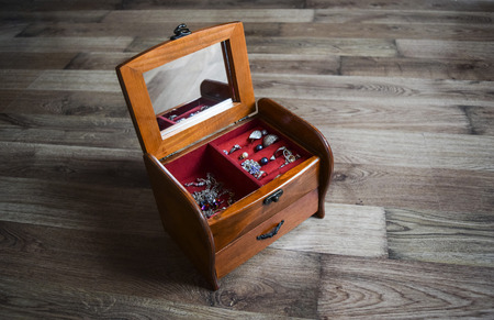 beautify: Jewelry wooden box with jewelry on the floor
