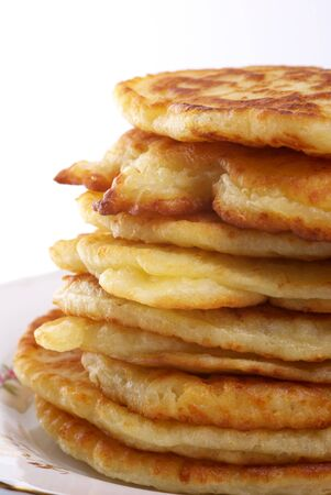 cheesy: Stack of cheesy pancakes on the white background.