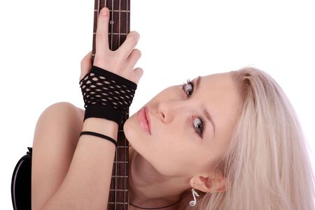 Young blond woman portrait with electric rock guitar, isolated on the white background.