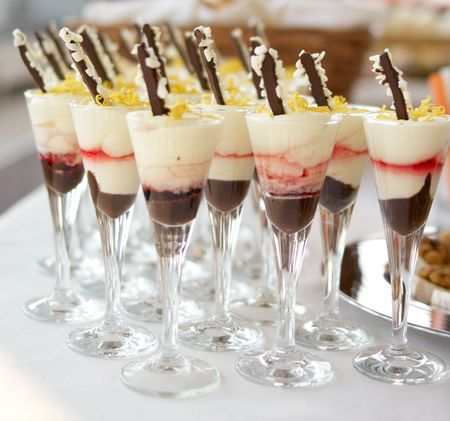 Wineglasses with sweet chocolate and orange mousse dessert.