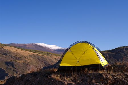 brink: Yellow tourist tent stends on the brink of a precipice