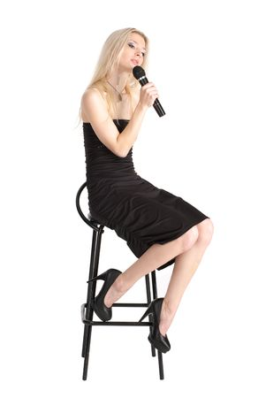 Young female in the black dress singing, over white