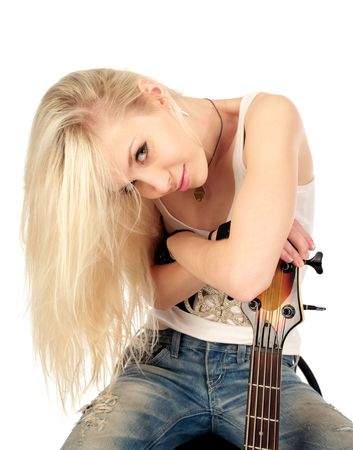 Portrait of pretty blond woman with electric rock guitar, isolated on the white background. photo