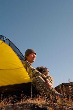Tourist and his dog Relaxing in the yellow tent photo