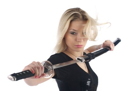 Beautiful woman in aggressive posture getting a sword on the white background
